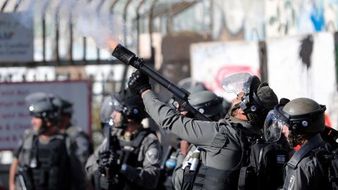 Israeli forces clash with Palestinian protesters near an Israeli checkpoint in Bethlehem on Thursday.