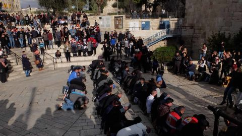 Muslims pray at the Damascus Gate entrance to Jerusalem's Old City on Thursday.
