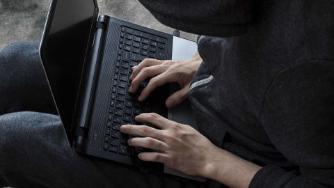 Hacker stealing password and identity, computer crime; Shutterstock ID 524144803; Job: -
