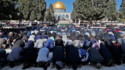 Palestinian Muslim worshippers pray in front of the Dome of the Rock mosque at the al-Aqsa mosque compound in the Jerusalem's Old City on December 8, 2017.