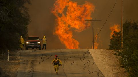 Flames rise as a fire approaches the Lake Casitas area of Ojai on December 8.
