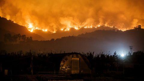 The Thomas Fire burns in the mountains near Carpinteria on Sunday, December 10.