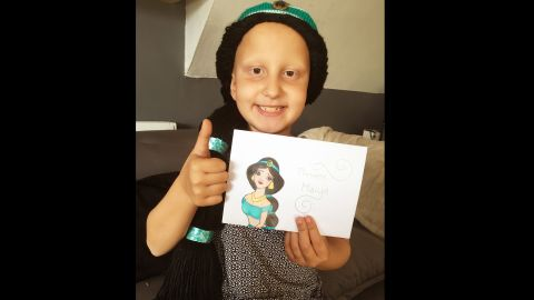 """Eight-year-old Maiya, who has alopecia totalis, received a Jasmine wig from the Magic Yarn Project after losing all her hair. The """"Aladdin"""" heroine is one of her favorite princesses because she followed her heart."""