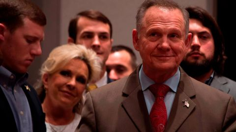 Republican Senatorial candidate Roy Moore stands off stage with his wife Kayla, second from left, before addressing his supporters in Montgomery, Alabama, on December 12, 2017.