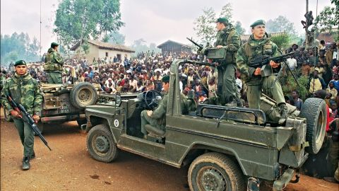 Hutus welcoming a French marines detachment as they drive through a refugee camp, some 4kms outside Butare, in July 1994.