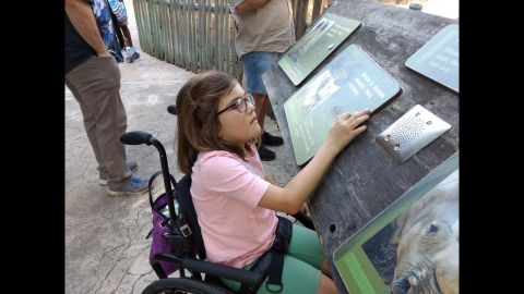 Avery can't read, but she's active and engages with every environment she encounters, like this day at the Houston Zoo.