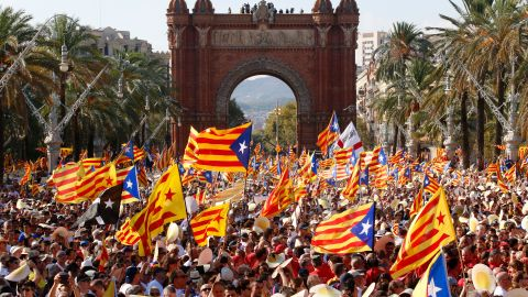 People wave the pro-independence Catalan flag at a rally on September 11, 2016, in Barcelona.