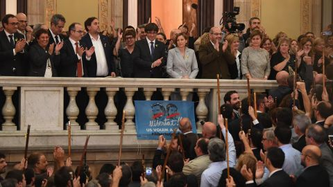 Catalan President Carles Puigdemont (center on balcony) addresses Catalan mayors after parliament declared unilateral independence, on October 27, 2017.