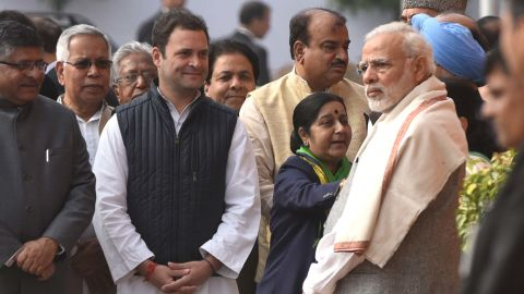 Indian Prime Minister Narendra Modi (R) stands near Rahul Gandhi (L) during the anniversary of the 2001 Parliament Attack at Parliament House on December 13, 2017, in New Delhi.