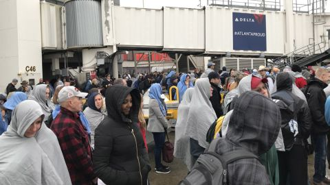 Passengers at Hartsfield-Jackson International Airport after Sunday's power outage.