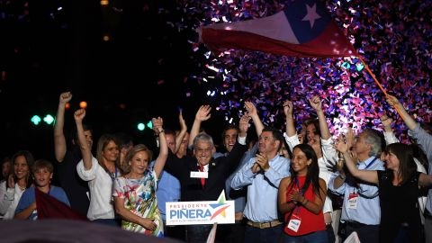 Chilean President-elect Sebastian Pinera, surrounded by family and supporters, celebrates his victory outside a Santiago hotel on December 17.
