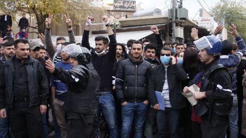Iraqi Kurdish protesters shout slogans in Sulaymaniyah on December 19.