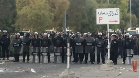 Security forces block the road during the anti-government protests in Sulaymaniyah.