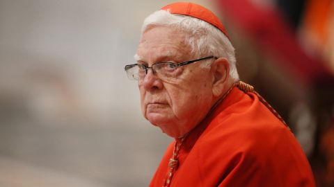 Cardinal Bernard Francis Law looks on as Pope Francis celebrates Mass in 2016 in Vatican City.