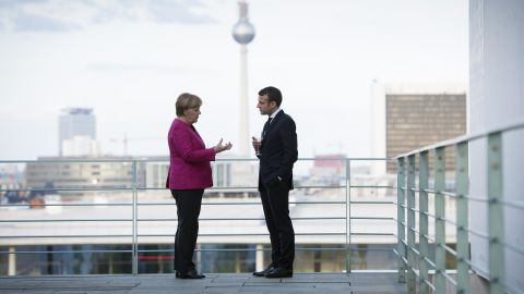 BERLIN, GERMANY - MAY 15:  In this handout photo provided by the German Government Press Office (BPA), German Chancellor Angela Merkel talks with newly-elected French President Emmanuel Macron on the terrace, with a view of the television tower in the background during his visit to the chancellor's office on May 15, 2017 in Berlin, Germany. Macron is visiting Berlin only a day after being sworn in as president in Paris. While Macron and Merkel have both demonstrated an unwavering commitment to the European Union and Merkel strongly applauded Macron's election, they are likely to differ over Macron's desire for E.U.-issued bonds, a measure Merkel has strongly opposed in the past.  (Photo by Guido Bergmann/Bundesregierung via Getty Images)