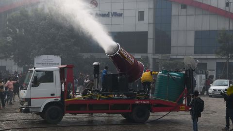 """A view of an anti-smog gun trial in New Delhi on December 20, 2017. India on December 20 unveiled a new weapon against air pollution -- an """"anti-smog gun"""" which authorities hope will clear the skies above New Delhi but which environmentalists say amounts to a band-aid solution. / AFP PHOTO / SAJJAD HUSSAIN        (Photo credit should read SAJJAD HUSSAIN/AFP/Getty Images)"""