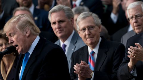 """House Majority Leader Representative Kevin McCarthy (R-CA) (2L), Senate Majority Leader Senator Mitch McConnell (R-KY) (C), US Vice President Mike Pence (2R), Speaker of the House Paul Ryan (R-WI) (R) and others listen while US President Donald Trump speaks about newly passed tax reform legislation during an event December 20, 2017 in Washington, DC. Trump hailed a """"historic"""" victory Wednesday as the US Congress passed a massive Republican tax cut plan, handing the president his first major legislative achievement since taking office nearly a year ago. / AFP PHOTO / Brendan Smialowski        (Photo credit should read BRENDAN SMIALOWSKI/AFP/Getty Images)"""