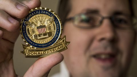 """John Wertman, a coin collector, with his Trump """"challenge coin"""" on December, 21, 2017 in Burke, VA."""