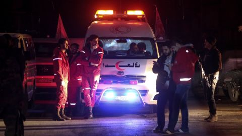 Syrian staff from the International Committee of the Red Cross take part in an evacuation operation in Douma in the eastern Ghouta region on the outskirts of the capital Damascus late on December 26, 2017.Aid workers have begun evacuating emergency medical cases from Syria's besieged rebel bastion of Eastern Ghouta, the International Committee of the Red Cross said, after months of waiting during which the UN said at least 16 people had died. Eastern Ghouta is one of the last remaining rebel strongholds in Syria and has been under a tight government siege since 2013, causing severe food and medical shortages for some 400,000 residents. / AFP PHOTO / Amer ALMOHIBANY        (Photo credit should read AMER ALMOHIBANY/AFP/Getty Images)