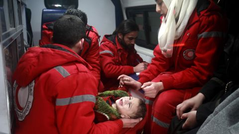 Syrian staff from the International Committee of the Red Cross evacuate a child from Eastern Ghouta on Wednesday.