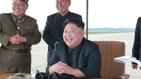 """This undated picture released from North Korea's official Korean Central News Agency (KCNA) on September 16, 2017 shows North Korean leader Kim Jong-Un (R) inspecting a launching drill of the medium-and-long range strategic ballistic rocket Hwasong-12 at an undisclosed location. Kim vowed to complete North Korea's nuclear force despite sanctions, saying the final goal of his country's weapons development is """"equilibrium of real force"""" with the United States, state media reported on September 16.  NK leadership watch says:  Kim Jong Un watches a missile drill on September 15, 2017. Also in attendance behind him are Kim Jong Sik and Ri Pyong Chol (Photo: KCNA)."""