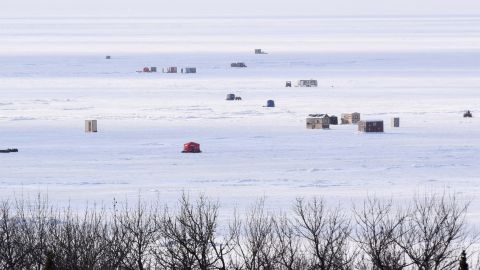 The cold weather spurred ice fishers to stake out spots on Upper Red Lake in Minnesota.