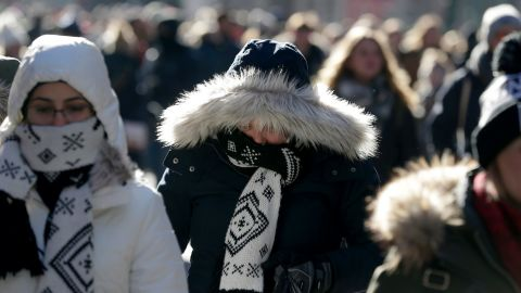 People try to keep warm in New York's Times Square on December 27.