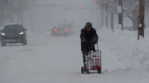 A man in Erie, Pennsylvania, walks with his groceries in a cart on December 29.