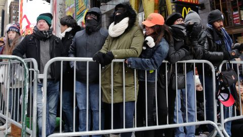 New Yorkers, celebrity entertainers and tourists from around the world packed into Times Square Sunday for what's expected to be a flashy but frigid celebration.
