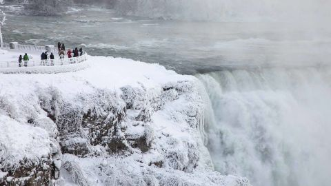 Visitors view Niagara Falls in New York on Sunday, December 31.