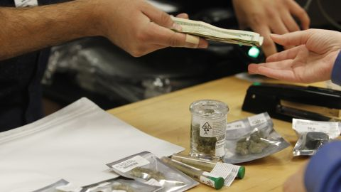 A customer buys marijuana at Harborside marijuana dispensary in Oakland.