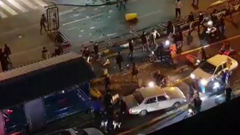 """An image grab taken from a handout video released by Iran's Mehr News agency reportedly shows a group of men pushing traffic barriers in a street in Tehran on December 30, 2017. Ten people died overnight in fresh unrest in Iran, local media reported on January 1, 2018, despite President Hassan Rouhani calling for calm and vowing more """"space for criticism"""" in a bid to head off days of protest. / AFP PHOTO / MEHR NEWS / Handout / RESTRICTED TO EDITORIAL USE - MANDATORY CREDIT """"AFP PHOTO / HO / MEHR NEWS"""" - NO MARKETING NO ADVERTISING CAMPAIGNS - DISTRIBUTED AS A SERVICE TO CLIENTS  NO RESALE - NO BBC PERSIAN / NO VOA PERSIAN / NO MANOTO TVHANDOUT/AFP/Getty Images"""