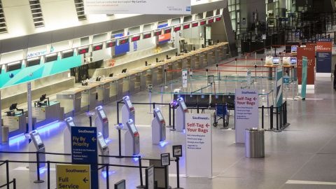 A check-in area stands empty at Boston's Logan International Airport on January 3. Thousands of flights have been canceled across the country.