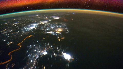 Bright swaths of red in the upper atmosphere, known as airglow, can be seen in this image from the International Space Station. NASA's ICON mission will observe how interactions between terrestrial weather and a layer of charged particles called the ionosphere create the colorful glow.