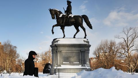 A pedestrian walks by a statue of George Washington in Boston's Public Garden on Friday, January 5, the morning after a massive storm. Blasts of arctic air have brought weather-related deaths, record low temperatures and historic amounts of snowfall to parts of the United States.
