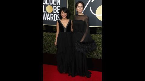 """Loung Ung, left, and Angelina Jolie. Ung, a spokeswoman for the Campaign for a Landmine-Free World, was one of <a href=""""http://www.cnn.com/2018/01/07/entertainment/golden-globes-activists-actresses-red-carpet/index.html"""" target=""""_blank"""">several activists</a> who appeared on the red carpet with actors."""