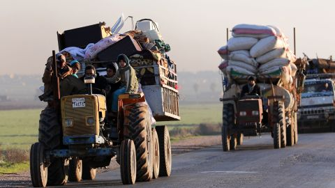 """Displaced Syrians who fled the fighting in Idlib province's southeastern town of Sinjar drive on a road in a rebel-held area near the city of Saraqib on January 7, 2018. Syrian troops captured Sinjar, the """"biggest town in southeast Idlib"""", from Syria's former Al-Qaeda affiliate and were within 14 kilometres (9 miles) of the Abu al-Duhur military base, the British-based Syrian Observatory for Human Rights said.  / AFP PHOTO / OMAR HAJ KADOUR        (Photo credit should read OMAR HAJ KADOUR/AFP/Getty Images)"""