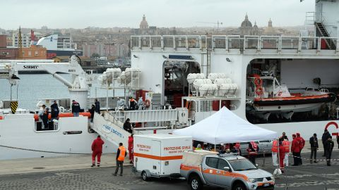 """Rescuers disembark the bodies of migrants on January 8, 2018 after the Italian Coast Guard vessel """"Diciotti"""" arrived in the port of Catania following a rescue operation of migrants and refugees at sea. At least 25 people are feared to have drowned in a shipwreck off Libya after a dinghy, possibly carrying some 150 migrants, ran into trouble, two rescue organisations said on January 6, 2018.  The Italian coast guard told AFP 85 people had been rescued from the sinking vessel, and eight bodies recovered so far."""