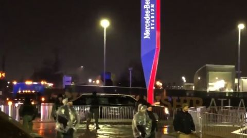 Crowds standing in the rain and booing the Trump motorcade outside MB Stadium.    Fans standing outside of Mercedes Benz stadium booed President Trump's motorcade as it drove by.  CNN Sports Andy Scholes was outside and said the stadium was locked down and fans were waiting in the rain to get in.