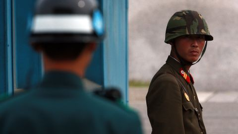 PANMUNJOM, SOUTH KOREA - SEPTEMBER 29:  (SOUTH KOREA OUT)  In this handout photo from Chosun Daily News, a North Korean Soldier (R) looks at South Korean soldier at the border village of Panmunjom between North and South Korea on September 29, 2010 in Panmunjom, South Korea. The two Koreas plan to hold military talks in Panmunjom in an attempt to ease tensions between the countries. The mooted talks come in the wake of speculation over the succession of leader Kim Jong-il by his son Kim Jongun. (Photo by Lee Tae-Kyung/Getty Images)