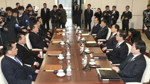 South Korean Unification Minister Cho Myoung-gyon, third from right, and the head of North Korean delegation Ri Son Gwon, third from left, with their delegation meet at the Panmunjom in the Demilitarized Zone in Paju, South Korea on Tuesday.