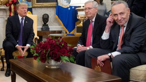 US President Donald Trump, meets with Congressional leadership including Senate Majority Leader Mitch McConnell (C), Republican of Kentucky, and Senate Minority Leader Chuck Schumer (R),  in the Oval Office at the White House in Washington, DC, December 7, 2017. / AFP PHOTO / SAUL LOEB        (Photo credit should read SAUL LOEB/AFP/Getty Images)