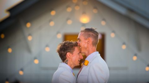 Australian Commonwealth Games sprinter Craig Burns (R) and fiance Luke Sullivan (L) prepare ahead of their marriage ceremony at Summergrove Estate, New South Wales on January 8, 2018. Australia officially become the 26th country to legalise same-sex marriage after the law was passed on December 9, 2017, with the overwhelming backing of the Federal Parliament. / AFP PHOTO / Patrick HAMILTON        (Photo credit should read PATRICK HAMILTON/AFP/Getty Images)