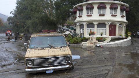 A van is stuck in the mud in the Sun Valley neighborhood of Los Angeles on January 9, 2018.