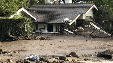 This photo provided by the Santa Barbara County Fire Department shows a home that has been buried in flood debris in Montecito, Calif., Tuesday, Jan. 9, 2018. Several homes were swept away before dawn Tuesday when mud and debris roared into neighborhoods in Montecito from hillsides stripped of vegetation during the Thomas wildfire.