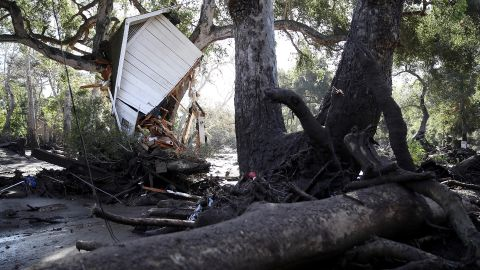 Part of a structure sits in a tree after being knocked off its foundation by a Montecito mudslide on January 10, 2018.