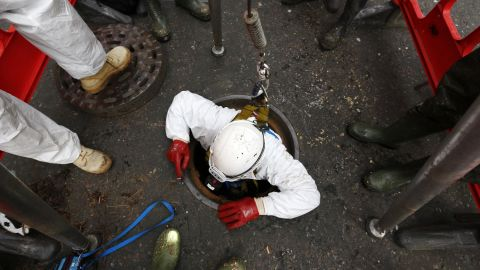 A Thames Water sewer engineer working on a fatberg in London in 2014.