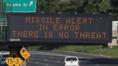 """An electronic sign reads, """"Missile alert in error. There is no threat."""""""
