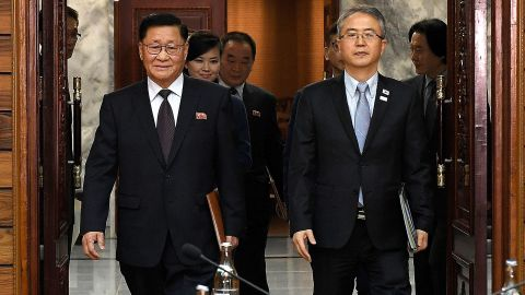 In this handout image provided by the South Korean Unification Ministry, the head of South Korean delegation Lee Woo-Sung (right) and the head of North Korean delegation Kwon Hook-Bong (left) arrive for their meeting on Monday in Panmunjom.
