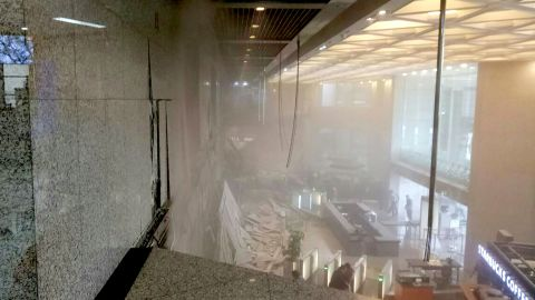 Photo shows dust still clouding the lobby after an internal balcony collapsed at Indonesia's stock exchange in Jakarta on January 15, 2018.